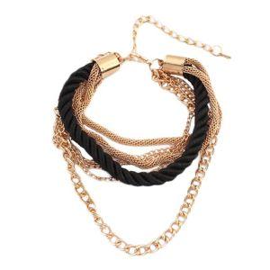 Bransoletka na rękę - skręcona czarna spirala ze sznurków, łańcuszki w złotym kolorze