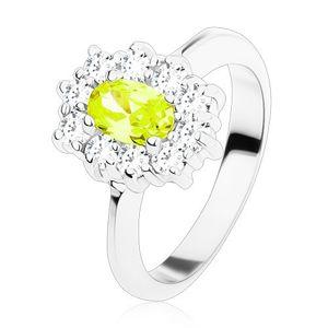 Pierścionek srebrnego koloru, żółto-zielona owalna cyrkonia otoczona okrągłymi bezbarwnymi cyrkoniami - Rozmiar : 49