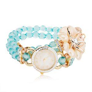 Zegarek na rękę z niebieskich koralików, cyferblat z cyrkoniami, biały kwiat
