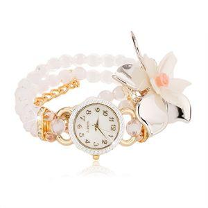 Zegarek z przejrzystych białych koralików, duży kwiat, cyferblat z cyrkoniami