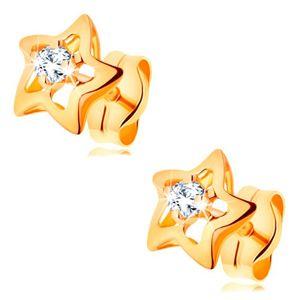 Złote 585 kolczyki - błyszczące gwiazdeczki z bezbarwną cyrkonią pośrodku