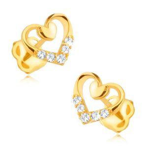 Złote kolczyki 585 - symetryczny zarys serca z mniejszym pełnym serduszkiem, cyrkonie